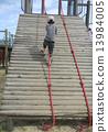 Climbing a rope 13984005