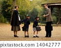 Family of four in park beside bandstand 14042777