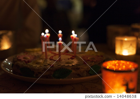 Birthday cake with candles and colorful bokeh 14048638
