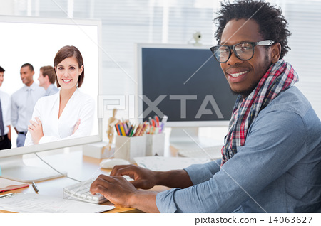 Stock Photo: Composite image of confident manager in front of her team with f