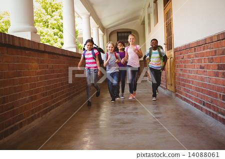 Stock Photo: School kids running in school corridor