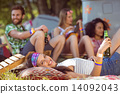 Happy hipsters relaxing on the campsite 14092043