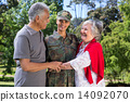 Soldier reunited with her parents 14092070