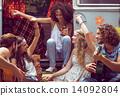 Hipster friends by camper van at festival 14092804