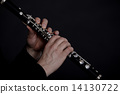 Clarinet player in front of black background 14130722