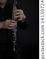 Clarinet player in front of black background 14130724