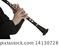 Clarinet player in front of white background 14130728