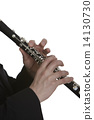 Clarinet player in front of white background 14130730