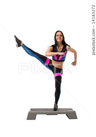 Vigorous athletic girl exercising on stepper 14183272
