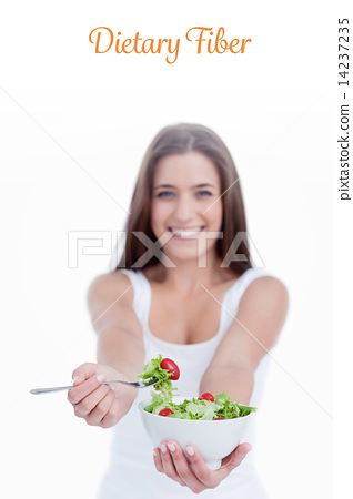 Dietary fiber against delicious salad being eaten by a young wom 14237235