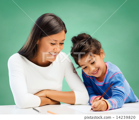Stock Photo: happy teacher and little school girl drawing