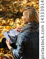 The girl  in the autumn park 14333914