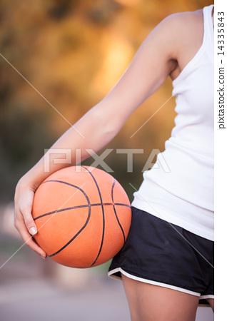 Stock Photo: girl with a basketball ball
