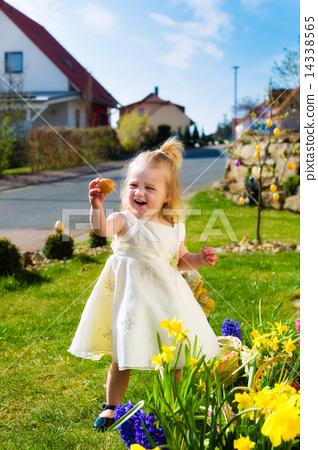 Girl on Easter egg hunt with eggs 14338565