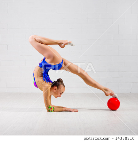 Girl is engaged in art gymnastics 14358510