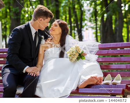 Groom embrace  bride  outdoor. 14404072