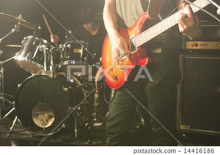 Live gigs of a rock band playing at the underground live venue (guitar and drum) 14416186