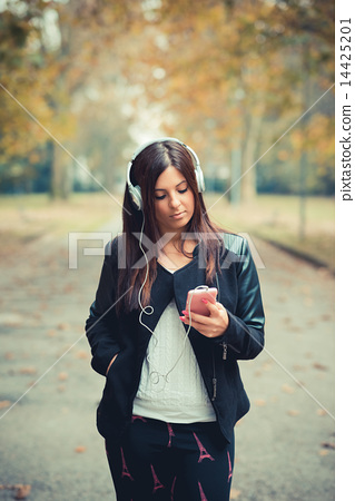 young beautiful brunette straight hair woman in the park 14425201