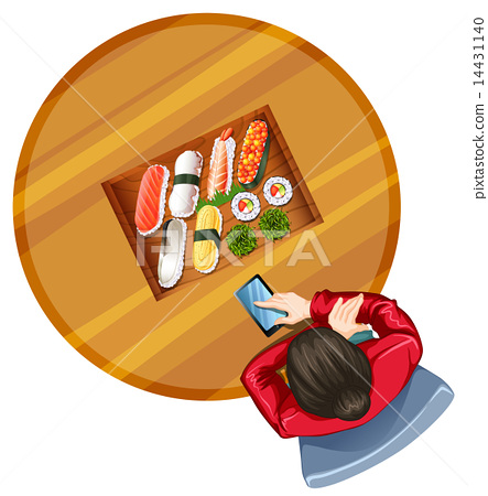 A topview of a girl at the table with sushi 14431140