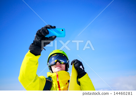 Man in winter clothes taking a selfie 14460281