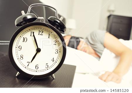 Stock Photo: alarm clock and man sleeping bed with sleep mask