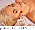 Doctor woman giving botox injections. 14728611