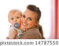 Portrait of beautiful young mother with her baby 14787550