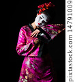 Portrait of geisha dancing isolated on black 14791009
