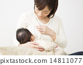 Mother holding a baby 14811077