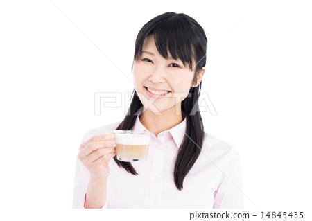 A woman drinking coffee 14845435