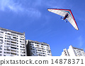 Hang glider over buildings 14878371