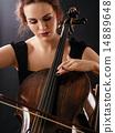 Closeup of a beautiful cellist 14889648