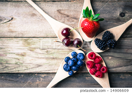 Berries on wooden rustic background 14906609