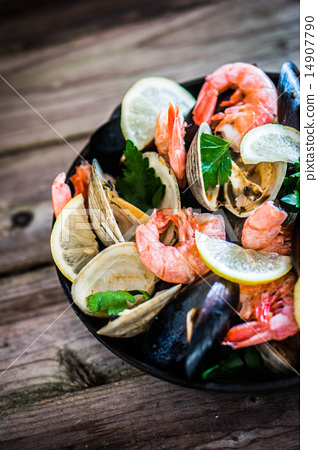 Mix of mussels,clams and shrimps on wooden background 14907790