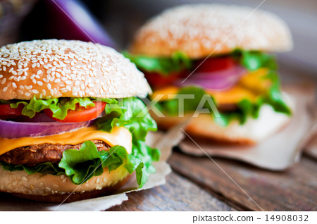 Closeup of home made burgers on wooden background 14908032