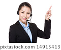 Customer services operator and finger point up 14915413