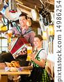 Bavarian restaurant with beer and pretzels 14986254