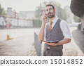 handsome big moustache hipster man with diary and smartphone 15014852