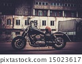 Custom made bobber motorcycle on a road 15023617
