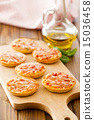 mini pizza on cutting board 15036458