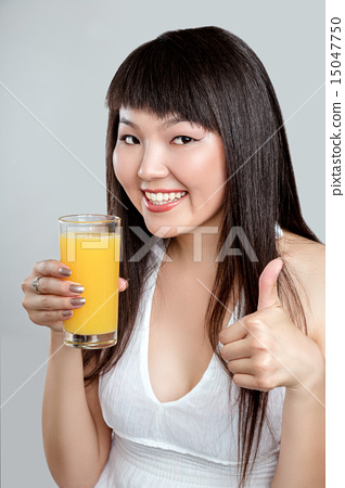 asian woman drinking orange juice 15047750