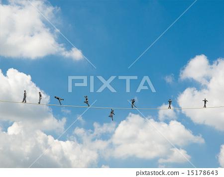 The tightrope walking businessmen 15178643