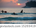 Boys on boards in sunset 15203419