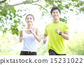 Young Chinese man and woman running in a park 15231022