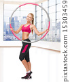 young sporty woman with hula hoop 15303459