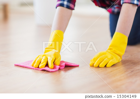 Stock Photo: close up of woman with rag cleaning floor at home