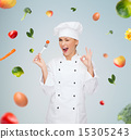 smiling female chef with fork and tomato 15305243