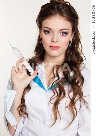 Young nurse with syringe on white background 15310756