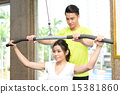 Young Chinese man and woman weights training 15381860