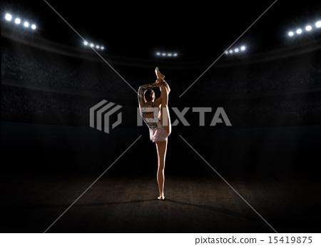 Young girl engaged art gymnastic 15419875